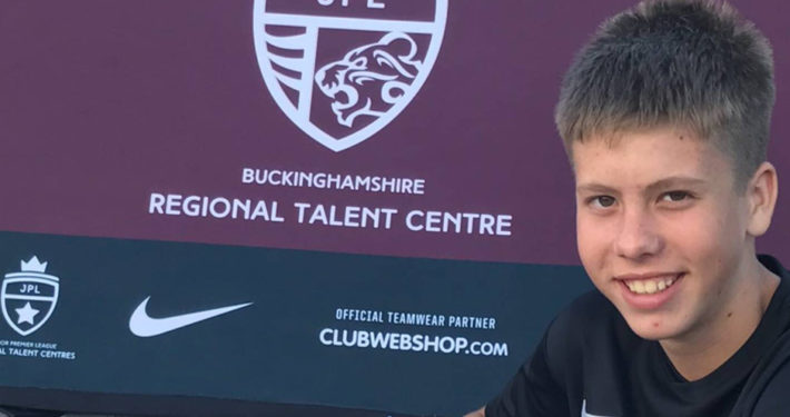 Young Player with Buckinghamshire RTC Banner